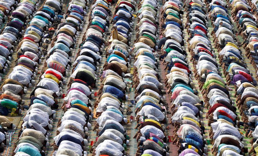 People offer their Eid prayers at the Feroz Shah Kotla dargah in Delhi. Reuters