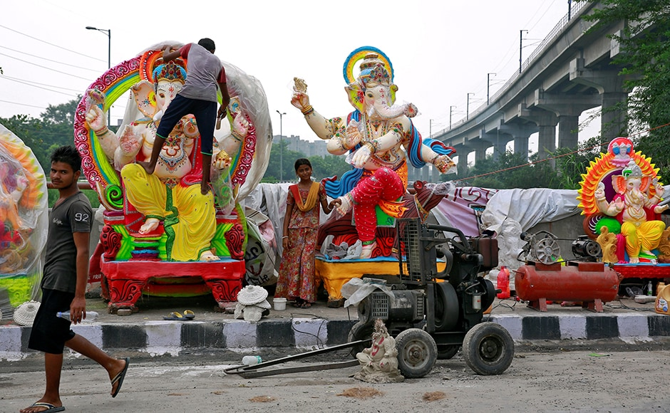 Workers transport an idol of Hindu god Ganesh, the deity of prosperity, on a cart ahead of the Ganesh Chaturthi festival, in Bengaluru. Reuters