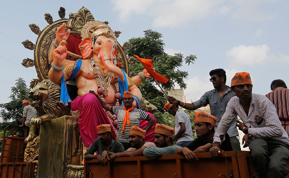 People transport an idol of Ganesha on a vehicle ahead of Ganesh Chaturthi festival in Ahmedabad. The ten-day long Ganesh festival begins on Sept. 5. AP