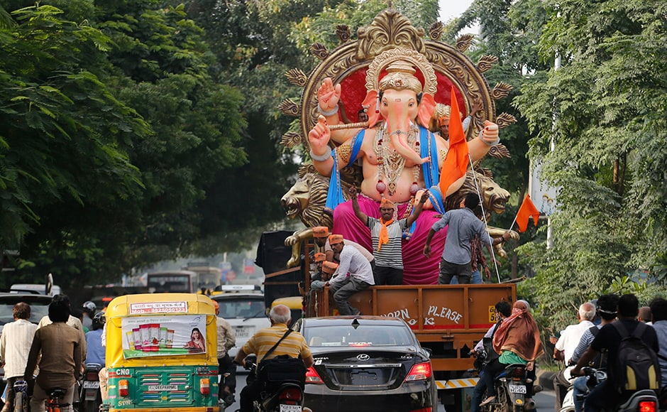 Ganesh Chaturthi is celebrated by families at home, by people at their places of work and in public. The public celebration involves installing clay images of Ganesha in public pandals (temporary shrines) and group worship. AP