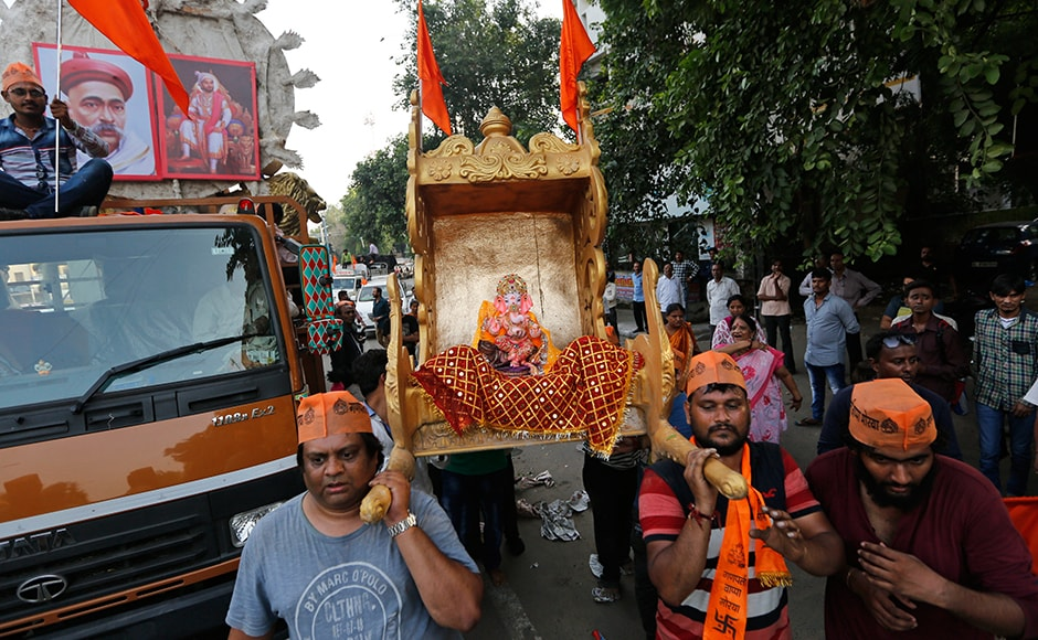 People carry an idol of Ganesha ahead of Ganesh Chaturthi festival in Ahmedabad. AP