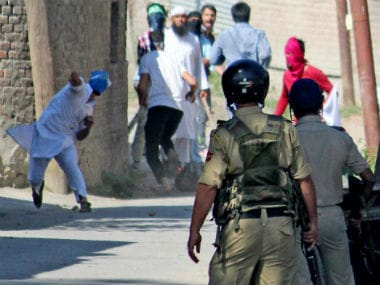 People pelt stones at police in Kashmir. PTI