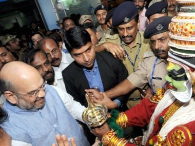 BJP president Amit Shah was given a traditional welcome on his arrival at the airport in Kozhikode on Thursday for National Council Meet. PTI