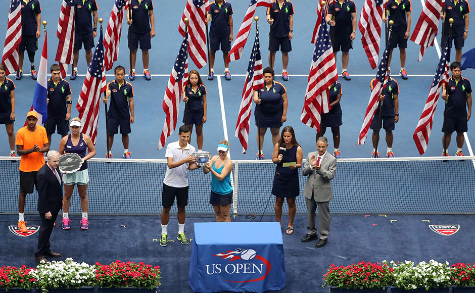 Laura Siegemund of Germany and Mate Pavic of Croatia hold the championship trophy after the match against Coco Vandeweghe and Rajeev Ram of the United States in the Mixed Doubles Finals. Reuters