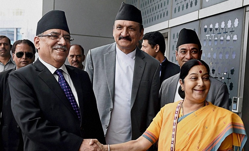 External Affairs Minister Sushma Swaraj receives Prime Minister of Nepal, Pushpa Kamal Dahal aka Prachanda on his arrival in New Delhi. PTI