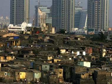 High rise buildings behind slums in India. Reuters