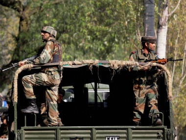 Soldiers stand outside the army base in Uri. PTI