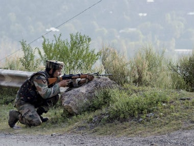 Soldiers outside the army camp which was attacked in Uri. PTI