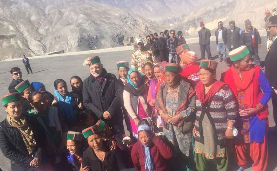 """PM Modi paid an impromptu visit to Chango village, close to Somdu, to wish people on Diwali. """"I was deeply touched by the impromptu reception and their joy,"""" he tweeted. (Photo: Twitter @narendramodi)"""