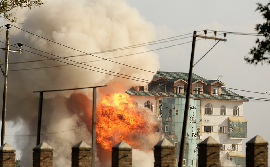 Two or three militants opened fire at security forces while they were dousing the fire which had engulfed the upper floor of the seven storey hostel building of EDI. Photo: AP