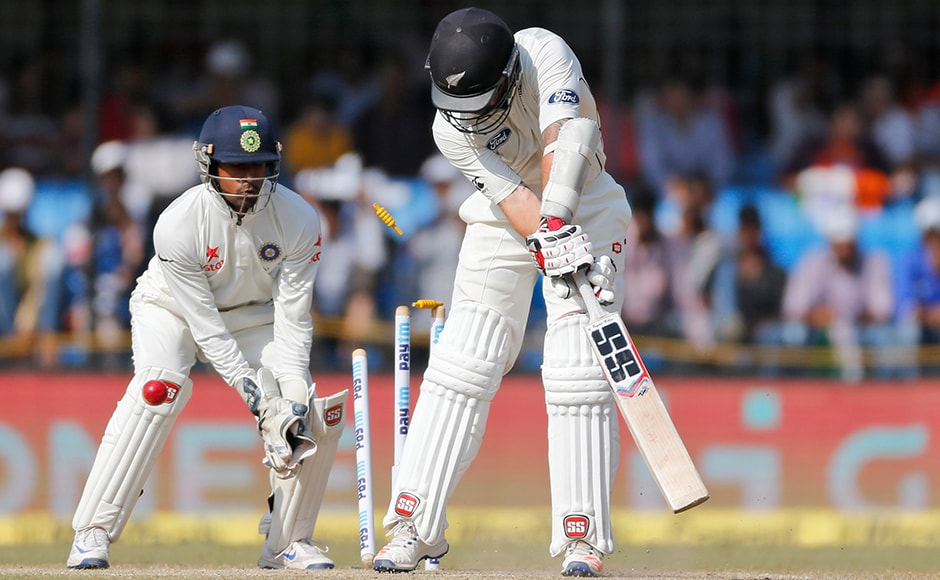 New Zealand's batsman Luke Ronchi is bowled out during the fourth day of the third test cricket match between India and New Zealand in Indore, India, Tuesday, Oct. 11, 2016. (AP Photo/Rafiq Maqbool)
