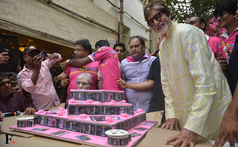 The birthday boy (man?) poses with his colourful birthday cake. Sachin Gokhale/Firstpost