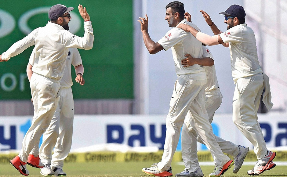 Indian players celebrate the fall of a wicket on the fourth day of the second Test match against New Zealand at Eden Garden in Kolkata on Monday. PTI Photo by Ashok Bhaumik(PTI10_3_2016_000074B)