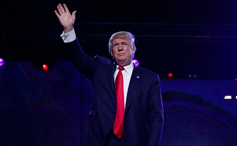 Donald Trump waves at visitors after speaking to the Republican Hindu Coalition on Saturday. AP