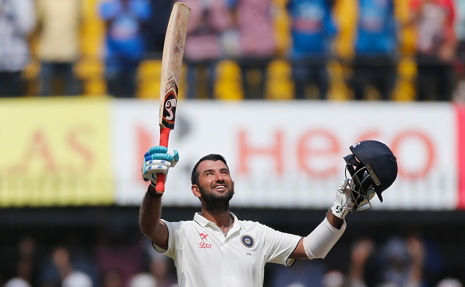 Indian batsman Cheteshwar Pujara celebrates his century during the fourth day of the third test cricket match between India and New Zealand in Indore, India, Tuesday, Oct. 11, 2016. (AP Photo/Rafiq Maqbool)