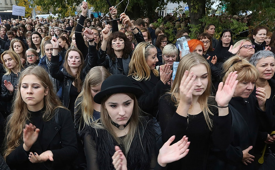 The strike and street demonstrations follow a street protest by thousands on Saturday in front of the parliament in Warsaw. Women wore black in a sign of mourning for the feared loss of reproductive rights and for the deaths that they feel some women would face. (Photo: AP)