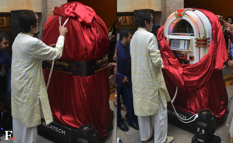 Bachchan curiously opening his gift. Sachin Gokhale/Firstpost