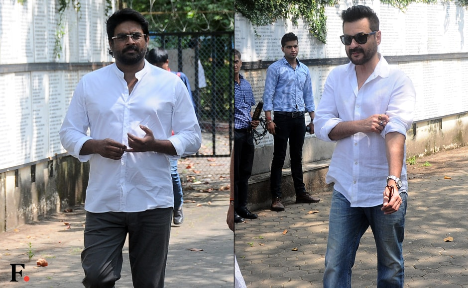 All through Monday morning, the Shettys' well-wishers from the film industry streamed in for the funeral. Seen here are R Madhavan and Sanjay Kapoor. Image by  Sachin Gokhale/Firstpost