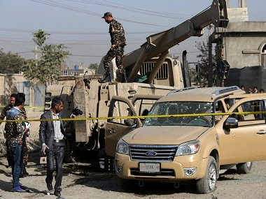 Afghan security personnel inspect the site of a bicycle bomb explosion targeted an army vehicle in Kabul, Afghanistan, Monday, Oct. 3, 2016. A police officer said an Afghan soldier was killed in the blast. (AP Photo/Rahmat Gul)