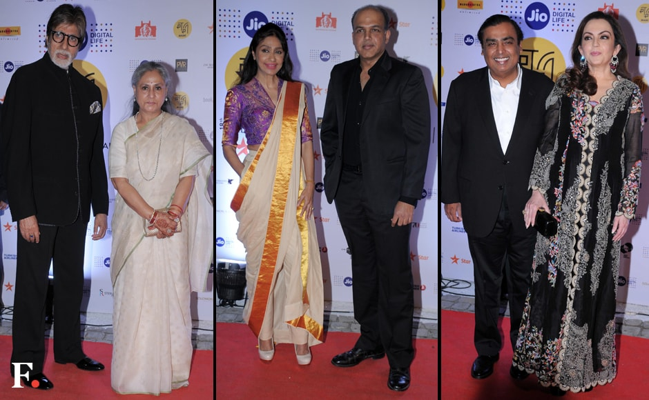 Amitabh Bachchan with wife Jaya Bachchan, Ashutosh Gowariker with wife Sunita Gowariker and Mukesh Ambani with wife Nita Ambani. Sachin Gokhale/Firstpost