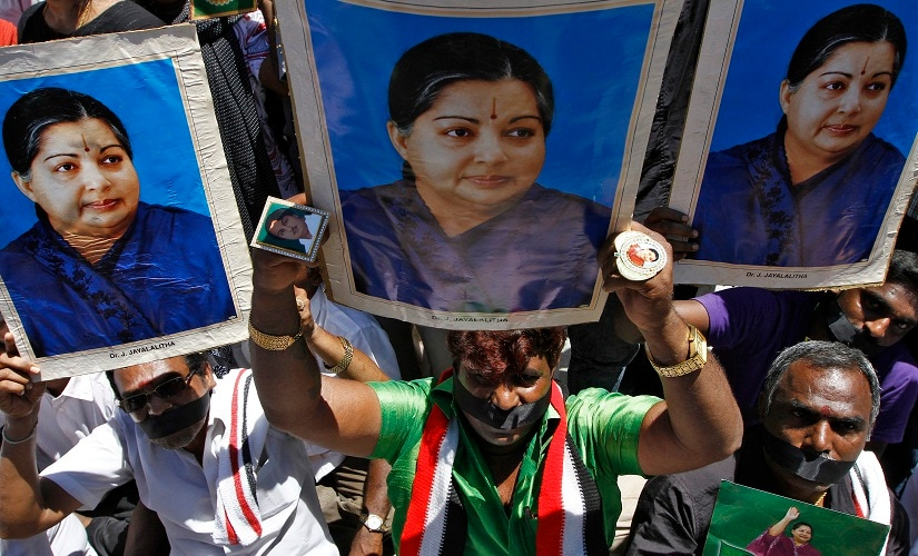 Supporters of J. Jayalalithaa, chief minister of India's Tamil Nadu state and chief of the AIADMK party, hold her posters as they sit on a fast during a protest against the court verdict in the southern Indian city of Chennai September 28, 2014. Jayalalithaa was sentenced to four years in jail on Saturday in a high-profile corruption case that has lasted nearly two decades. REUTERS/Babu (INDIA - Tags: POLITICS CIVIL UNREST) - RTR48072