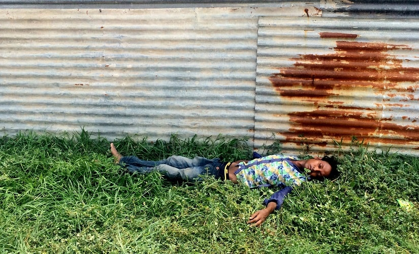 An addict passed out outside the New Usmanpur Police Station. Firstpost/Pallavi