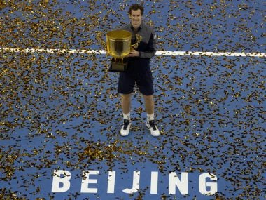 Andy Murray with his China Open trophy. AP