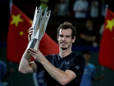 Andy Murray poses with the Shanghai Masters trophy after winning tournament. Reuters
