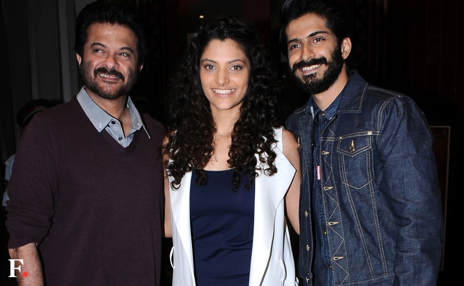 Anil Kapoor was the proud host, as he basked in his son's big screen debut. Anil is seen here with Saiyami and Harsh. Image by Sachin Gokhale/Firstpost
