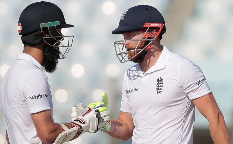 Day 1: England's Jonny Bairstow (52) and Moeen Ali's (68) cheer each other during the first day. AP