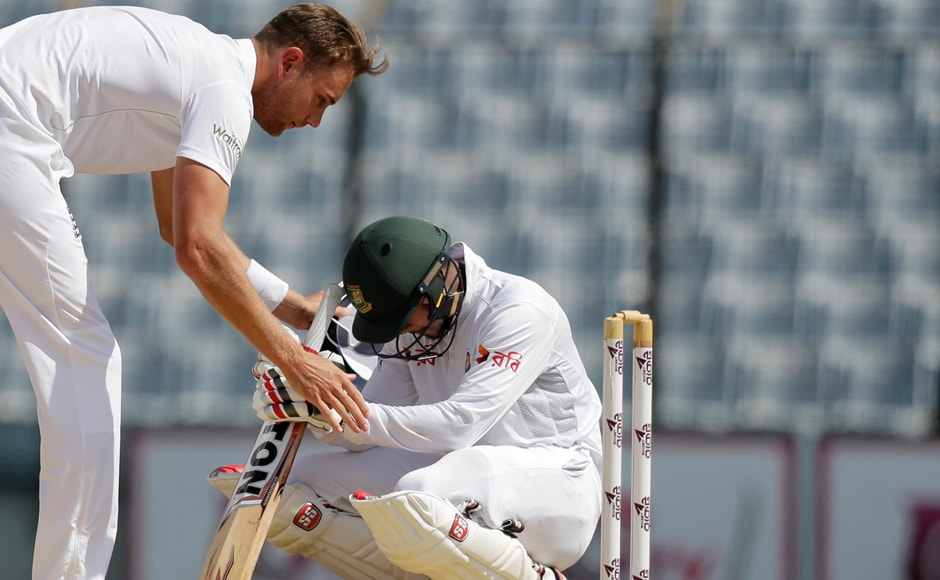 Day 5: Stuart Broad consoles Bangladesh's batsman Sabbir Rahman after he was left stranded on 64 runs, as England won against Bangladesh in their first Test in Chittagong. AP