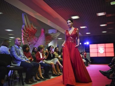 A model wears a creation by designer Micaela Oliveira during a presentation by Benfica. AFP