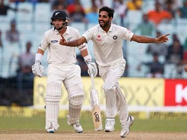 Bhuvneshwar Kumar, celebrates after taking the wicket of New Zealand's Matt Henry. AP