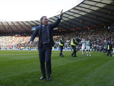 Brendan Rodgers gestures to fans after Celtic beat Rangers in the Scottish League Cup. Reuters