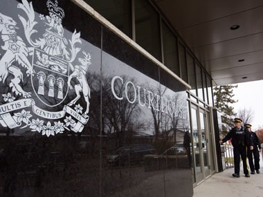 Royal Canadian Mounted Police officers arrive to court in Meadow Lake, Saskatchewan on Friday, AP