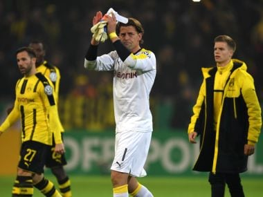 Borussia Dortmund players acknowledge the crowd after beating Hertha Berlin on penalties in the German Cup. AFP