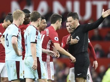 Mark Clattenburg sends Manchester United's Ander Herrera off with a red card. AFP