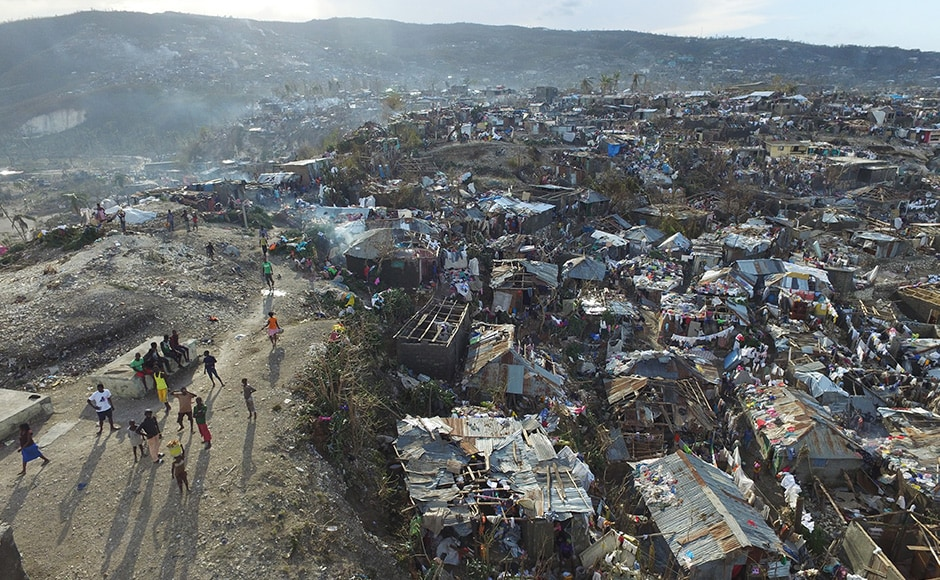 The number of deaths in Haiti, the poorest country in the Americas, surged to 877 on Friday as information trickled in from remote areas previously cut off by the storm. AP