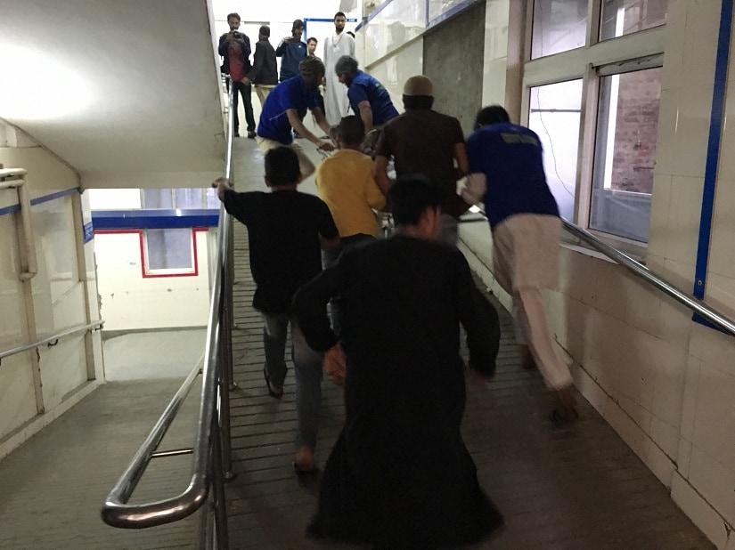 A pellet victim is rushed into Srinagar's SMHS Hospital
