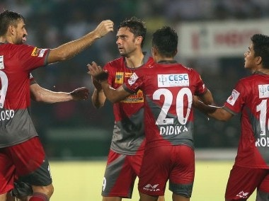 Atletico de Kolkata players congratulate Helder Postiga for scoring. ISL