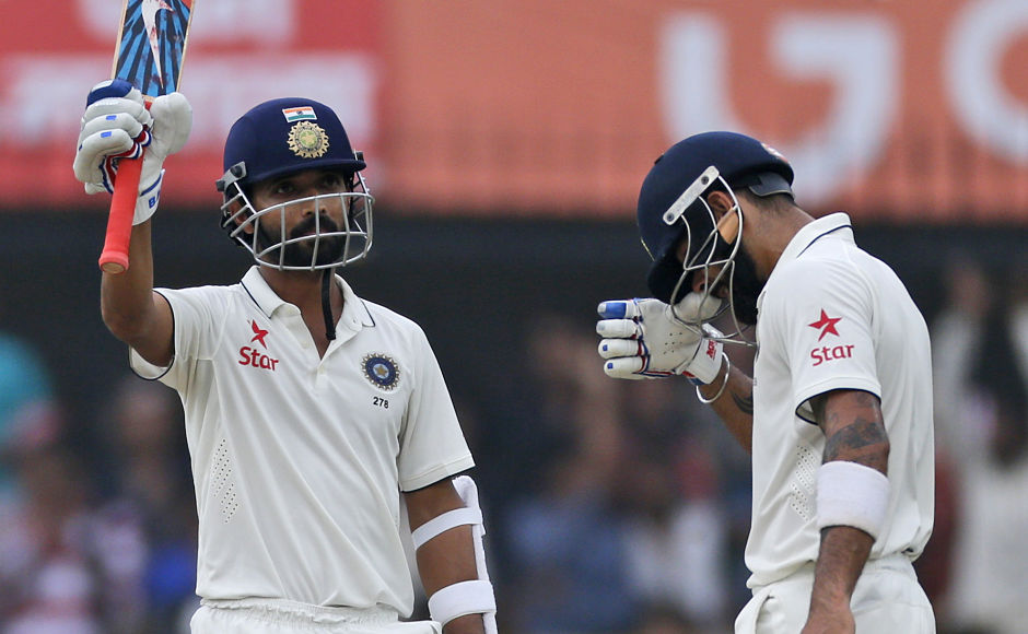 Indian batsman Ajinkya Rahane raises his bat after scoring a half century, with team captain Virat Kohli standing beside him on the first day of their third cricket test match against New Zealand in Indore, India, Saturday, Oct. 8, 2016. (AP Photo/Rafiq Maqbool)