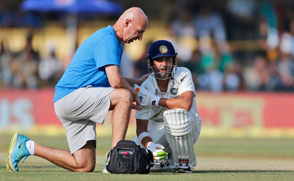 A team physiotherapist attends to Gautam Gambhir as the latter aggravated his shoulder injury after diving while coming back for a second run. He retired hurt for 6. AP