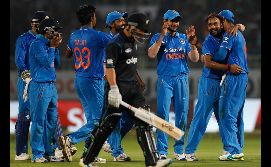 India's Amit Mishra celebrates with teammates after taking the wicket of New Zealand's BJ Watling. AP