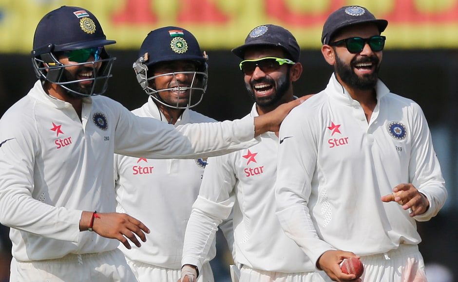 Virat Kohli and co celebrate the wicket of New Zealand's Mitchell Santner. AP