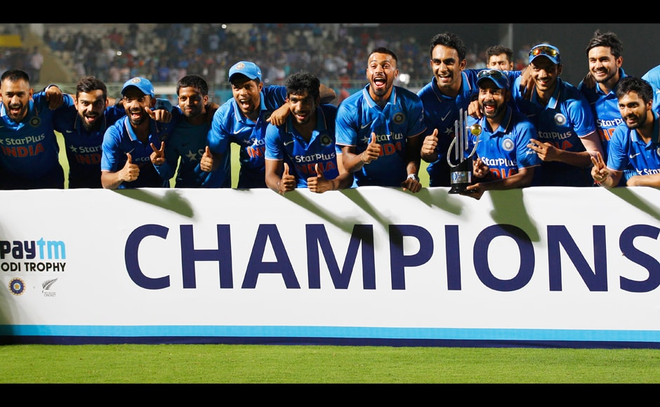 Members of the Indian cricket team celebrate with the winners trophy after their fifth ODI against New Zealand in Visakhapatnam. India won the series 3-2 after defeating Kiwis in the decider by 190 runs. AP
