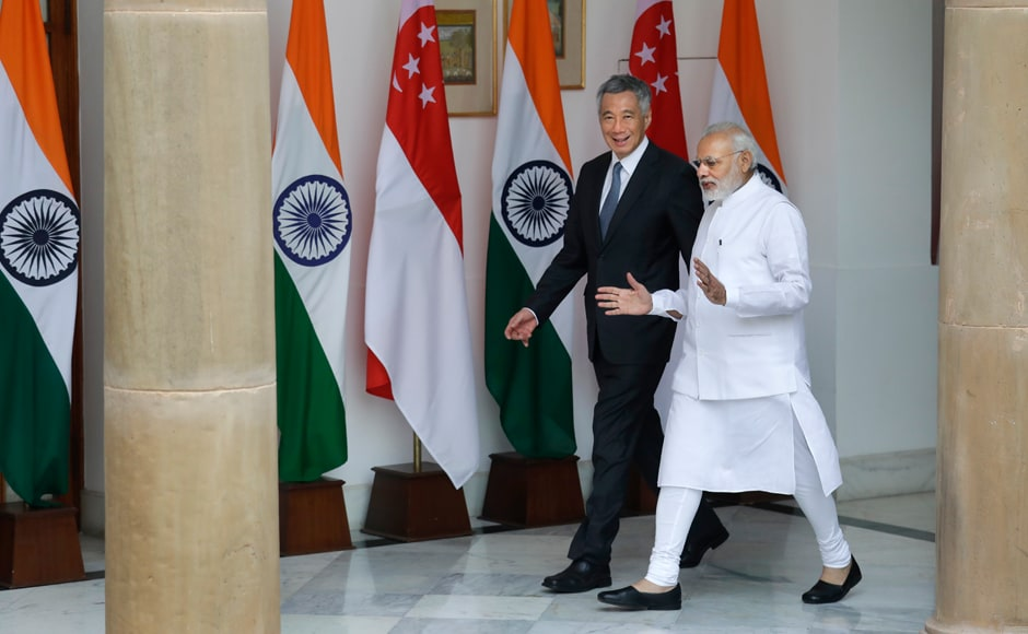 Indian Prime Minister Narendra Modi, right, talks with Singapore Prime Minister Lee Hsien Loong as they walk for a delegation level meeting, in New Delhi, India, on Tuesday. Lee is on a five day visit to India. AP