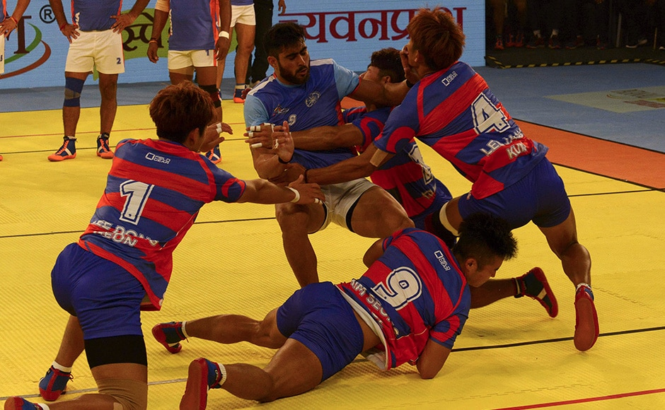 South Korean kabaddi players pounce on an Indian opponent during the 2016 Kabaddi World Cup in Ahmedabad. AFP