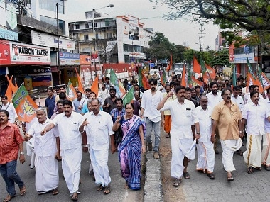 Kochi: BJP activists staging a protest march in Kochi as part of the state wide dawn to dusk strike on Thursday against kiiling of Ramit, a BJP worker, was hacked to death by alleged CPM workers in Pinarayi town of Kannur district ln Kerala. PTI Photo(PTI10_13_2016_000031B)
