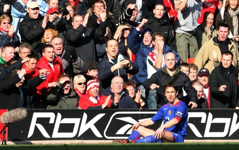 Liverpool supporters heckle Manchester United's Gary Neville during their FA Cup match at Anfield. Reuters