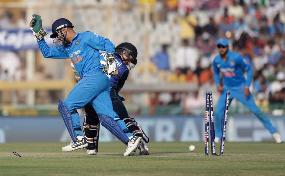 Quick hands! Captain MS Dhoni nicked the bails of Ross Taylor at first and then proceeded to get Luke Ronchi's number as well. AP